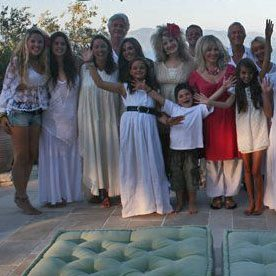 A group of friends all dressed in white (bar one who is in red) - getting ready for a night out in Paxos
