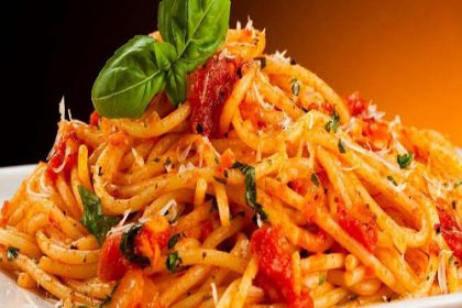 Bowl of delicious-looking tomato spaghetti with basil on top