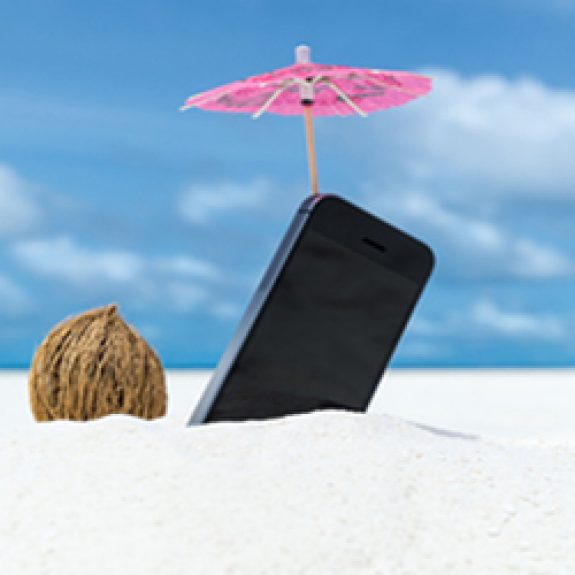 Mobile phone standing in sand