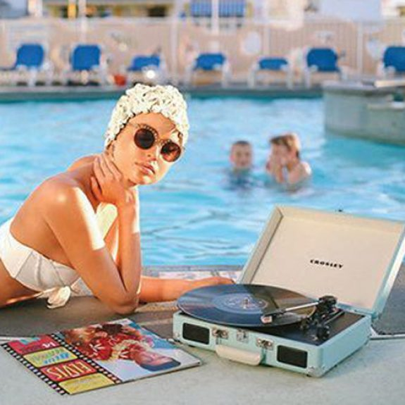Lady sits by Pool with record player