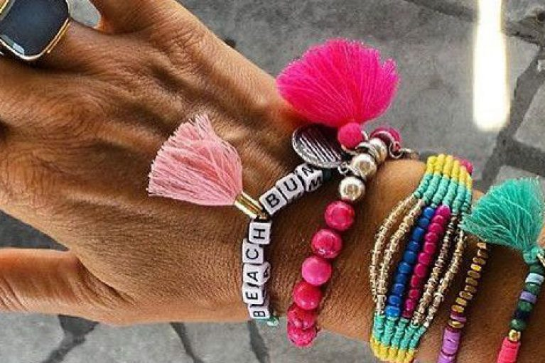 Woman's hand with vibrant bracelets